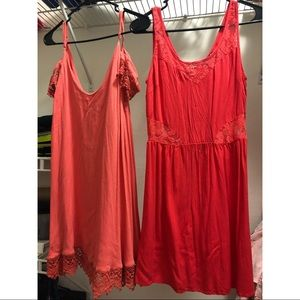 Two coral dresses